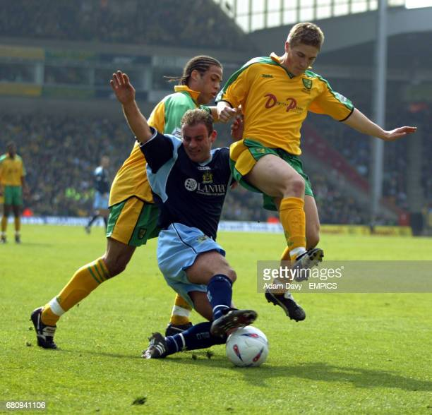 Norwich City's Paul McVeigh and Darel Russell sandwhich out Burnley's Paul Weller