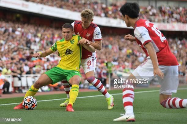 Norwich City's Polish midfielder Przemys?aw P?acheta vies with Arsenal's Norwegian midfielder Martin Odegaard during the English Premier League...