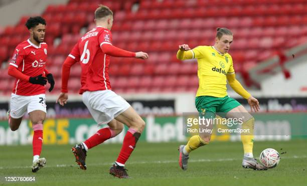 Norwich City's Przemyslaw Placheta under pressure from Barnsley's Mads Juel Andersen during the The Emirates FA Cup Fourth Round match between...