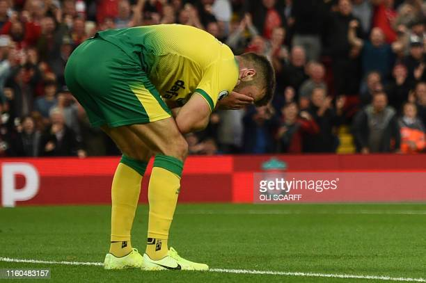 Norwich City's Scottish defender Grant Hanley reacts after scoring an own goal during the English Premier League football match between Liverpool and...