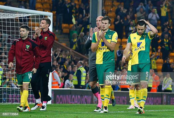 Norwich City's Scottish defender Russell Martin Norwich City's English defender Ryan Bennett and Norwich City's Irish midfielder Wes Hoolahan on the...