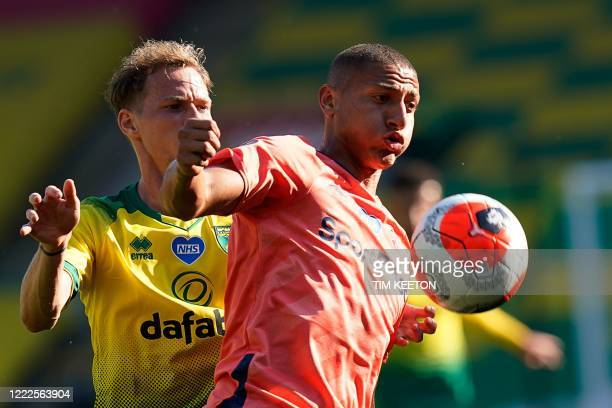 Norwich City's Slovakian midfielder Ondrej Duda vies for the ball with Everton's Brazilian striker Richarlison during the English Premier League...