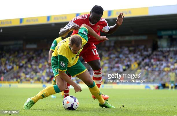 Norwich City's Steven Whittaker and Southampton's Victor Wanyama battle for the ball