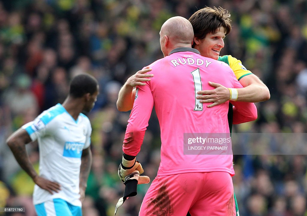 Norwich Citys Swiss midfielder Timm Klose (R) celebrates with Norwich Citys English goalkeeper John Ruddy after beating Newcastle in the English Premier League football match between Norwich City and Newcastle United at Carrow Road in Norwich, eastern England, on April 2, 2016. PARNABY