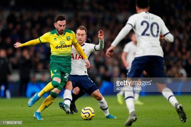 Norwich City's Swiss striker Josip Drmic is challenged by Tottenham Hotspur's Danish midfielder Christian Eriksen during the English Premier League...