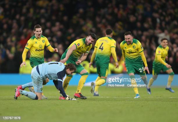 Norwich City's Tim Krul and Grant Hanley lead the celebrations after winning the penalty shootout during the FA Cup Fifth Round match between...
