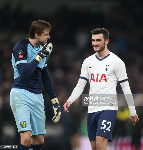 Norwich City's Tim Krul shares a joke with Tottenham Hotspur's Troy Parrott during the penalty shootout during the FA Cup Fifth Round match between...