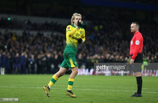 Norwich City's Todd Cantwell silences the Spurs fans after scoring a penalty in the shootout during the FA Cup Fifth Round match between Tottenham...