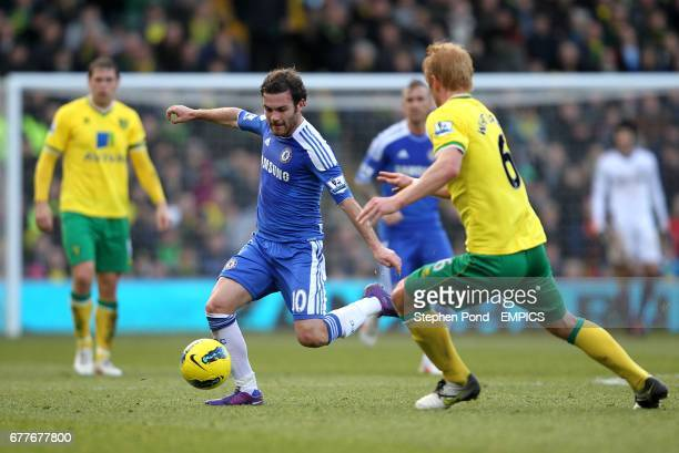 Norwich City's Zak Whitbread and Chelsea's Juan Mata battle for the ball