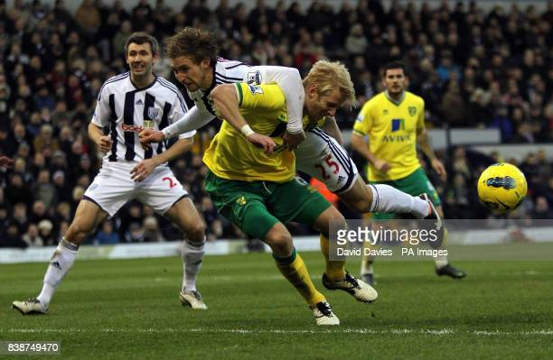 Norwich City's Zak Whitbread tangles with West Bromwich Albion's Craig Dawson during the Barclays Premier League match at The Hawthorns West Bromwich