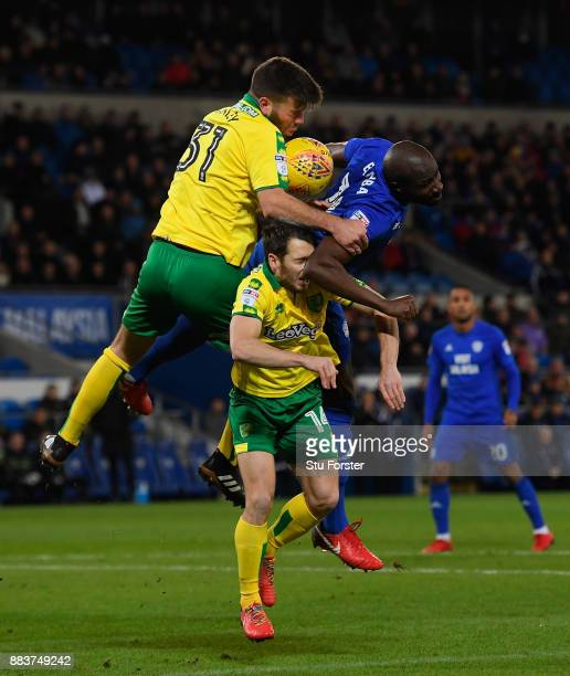 Norwich defender Grant Hanley and Wes Hoolahan challenges Sol Bamba of Cardiff during the Sky Bet Championship match between Cardiff City and Norwich...