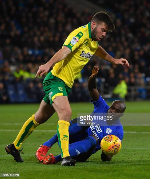 Norwich defender Grant Hanley challenges Sol Bamba of Cardiff during the Sky Bet Championship match between Cardiff City and Norwich City at Cardiff...