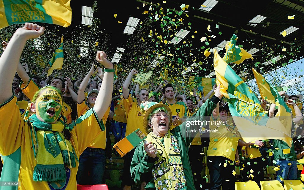 Norwich fans celebrate promotion to the Premier League during the Nationwide Division One match between Watford and Norwich City at Vicarage Road on April 24, 2004 in Watford, England.