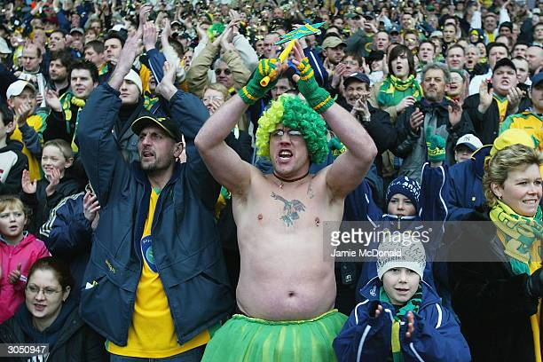Norwich fans celebrate victory during the Nationwide Division One match between Norwich City and Ipswich Town at Carrow Road on March 7 2004 in...