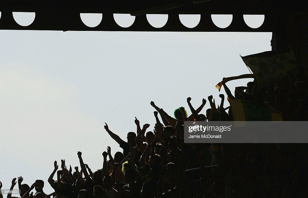 Norwich fans enjoy the moment during the Nationwide Division One match between Watford and Norwich City at Vicarage Road on April 24, 2004 in Watford, England.