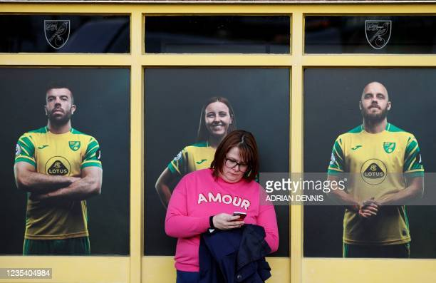 Norwich fans wait ousitde the ground ahead of the English League Cup third round football match between Norwich City and Liverpool at Carrow Road...