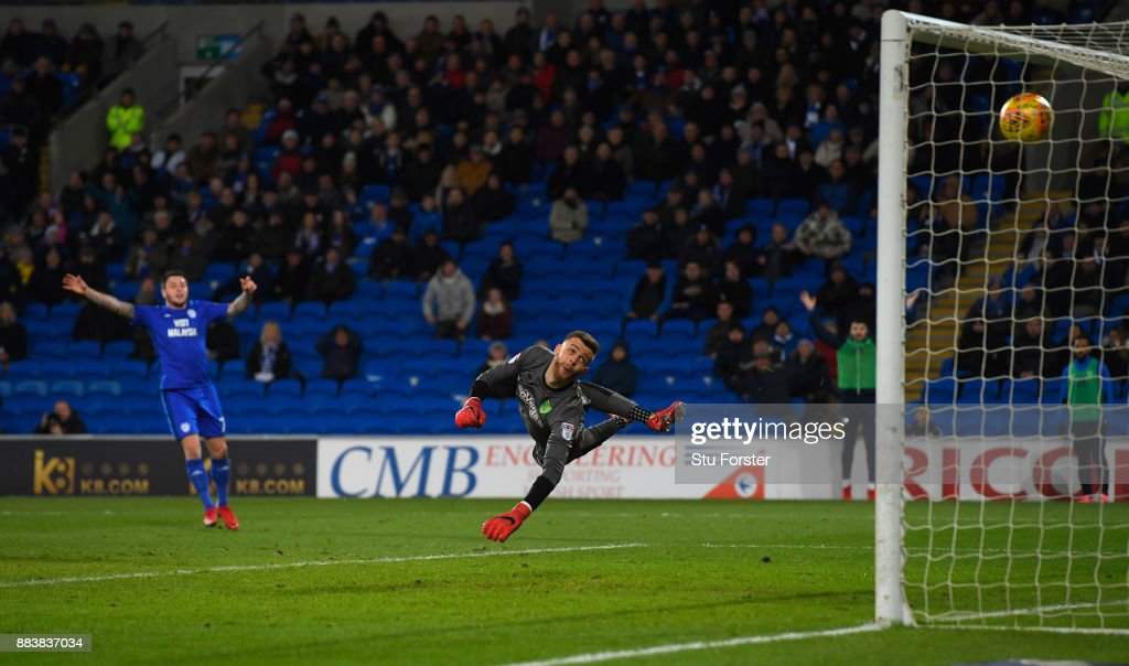 Norwich goalkeeper Angus Gunn is beaten by a shot from Junior Hoilett (not pictured) for the second Cardiff goal during the Sky Bet Championship match between Cardiff City and Norwich City at Cardiff City Stadium on December 1, 2017 in Cardiff, Wales.