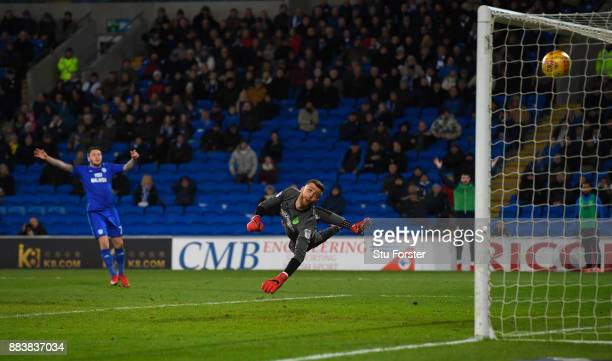 Norwich goalkeeper Angus Gunn is beaten by a shot from Junior Hoilett for the second Cardiff goal during the Sky Bet Championship match between...