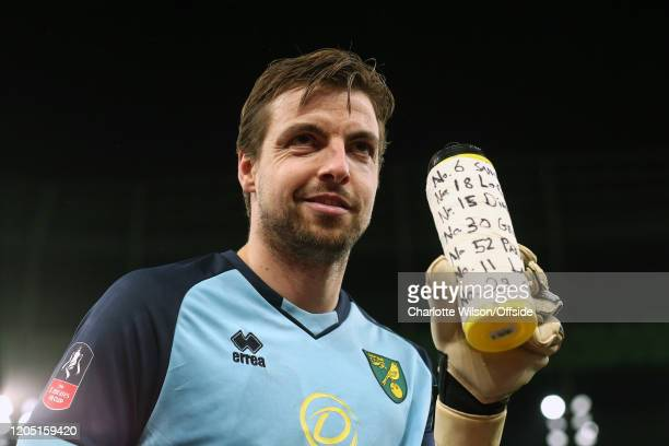 Norwich goalkeeper Tim Krul taunts Spurs fans with his water bottle which lists the Tottenham players and the predicted direction of their penalties...