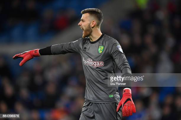 Norwich keeper Angus Gunn reacts during the Sky Bet Championship match between Cardiff City and Norwich City at Cardiff City Stadium on December 1...