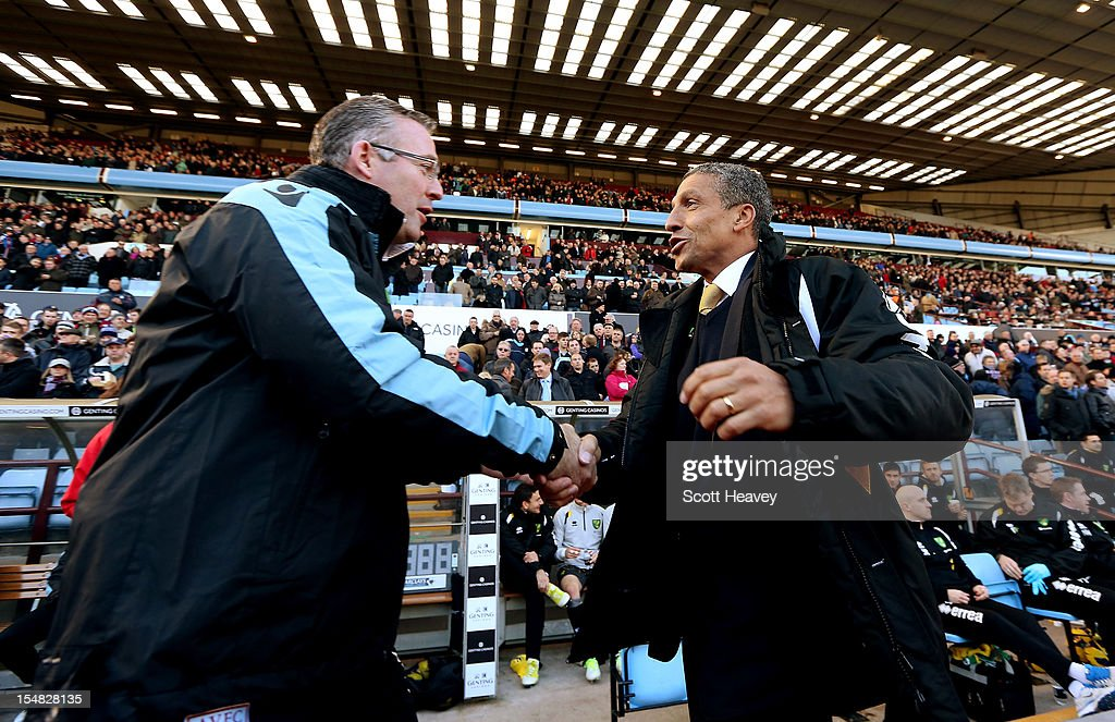 Norwich manager Chris Hughton (R) and Aston Villa manger Paul Lambert shake hands prior to kick off during the Barclays Premier League match between Aston Villa and Norwich City at Villa Park on October 27, 2012 in Birmingham, England.