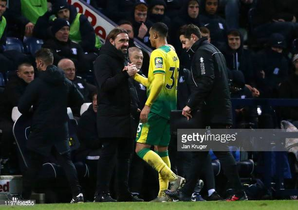 Norwich Manager Daniel Farke shakes hands with Adam Idah of Norwich after being substituted during the FA Cup Third Round match between Preston North...