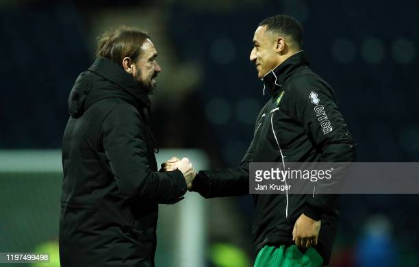 Norwich Manager Daniel Farke shakes hands with Adam Idah of Norwich after the FA Cup Third Round match between Preston North End and Norwich City at...
