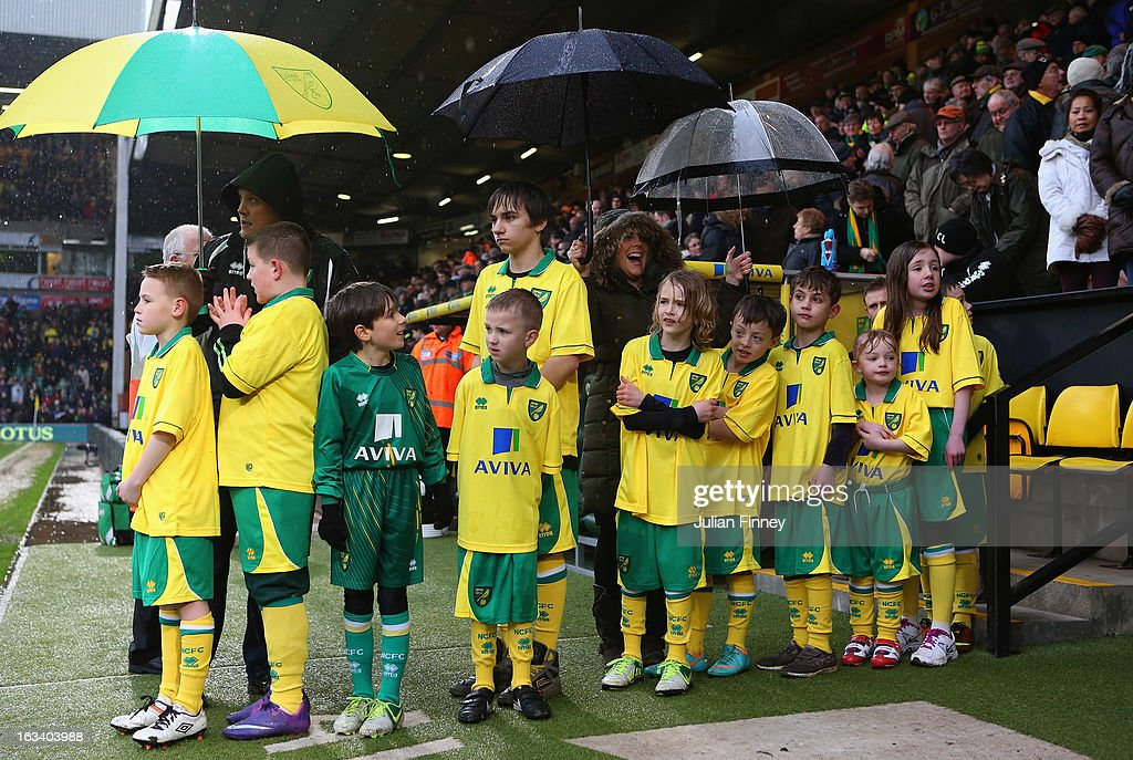 Norwich mascots shelter from the rain before the Barclays Premier League match between Norwich City and Southampton at Carrow Road on March 9, 2013 in Norwich, England.