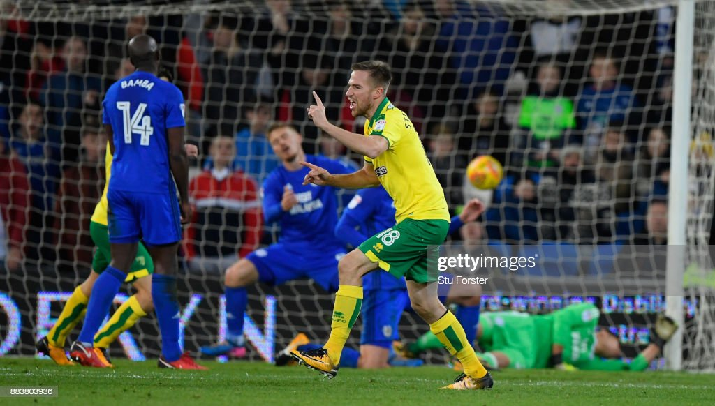 Norwich payer Marco Stiepermann watches his deflected shot go in for the first goal during the Sky Bet Championship match between Cardiff City and Norwich City at Cardiff City Stadium on December 1, 2017 in Cardiff, Wales.