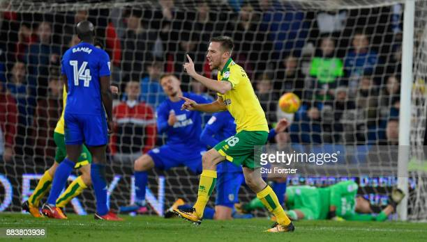 Norwich payer Marco Stiepermann watches his deflected shot go in for the first goal during the Sky Bet Championship match between Cardiff City and...