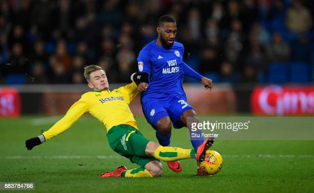 Norwich player James Maddison challenges Junior Hoilett of Cardiff during the Sky Bet Championship match between Cardiff City and Norwich City at...