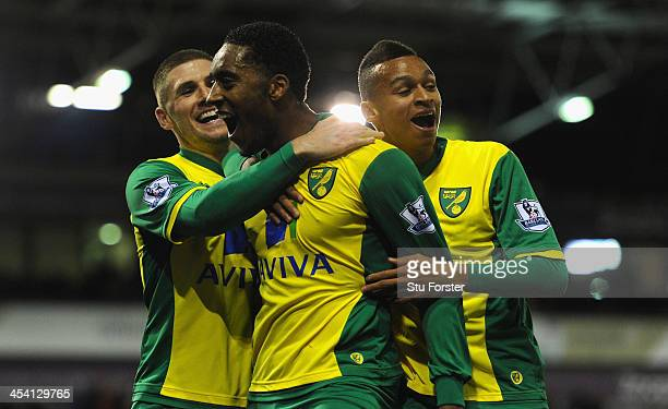 Norwich player Leroy Fer celebrates after scoring the second goal with Gary Hooper and Josh Murphy during the Barclays Premier League match between...