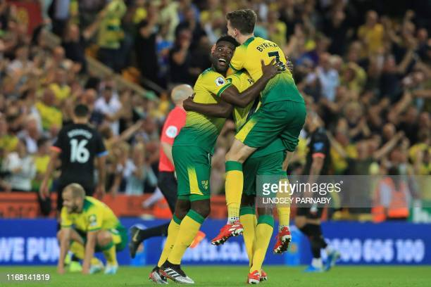 Norwich players celebrate their win on the final whistle in the English Premier League football match between Norwich City and Manchester City at...