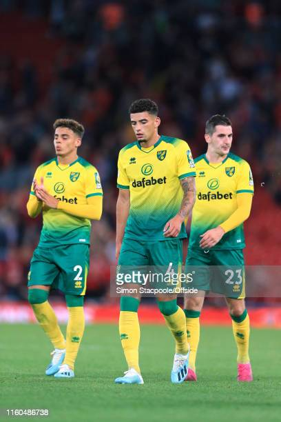 Norwich players Max Aarons Ben Godfrey and Kenny McLean look dejected after the Premier League match between Liverpool and Norwich City at Anfield on...