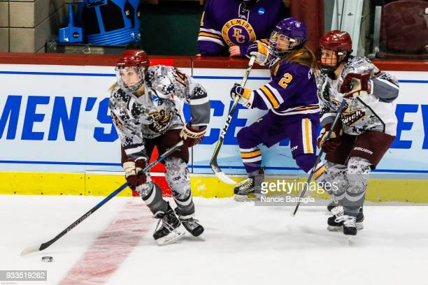 Norwich University's Nicole Goebel gets the puck along the boards during the Division 111 Women's Ice Hockey Championship held at Kreitzberg Arena on...