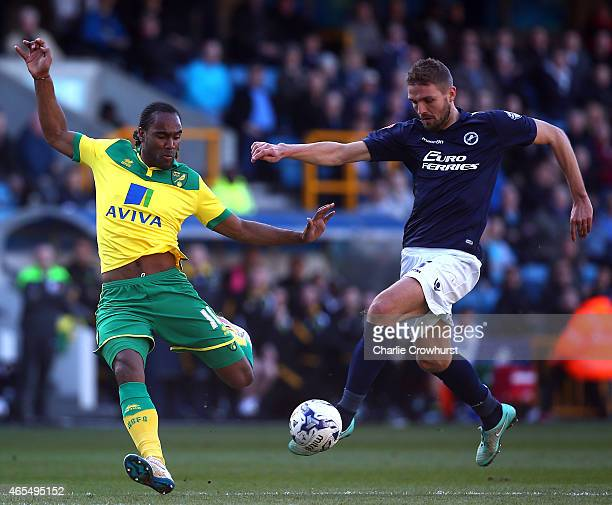 Norwich's Cameron Jerome is beaten to the ball by Millwall's Jos Hooiveld during the Sky Bet Championship match between Millwall and Norwich City at...