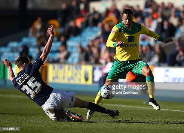 Norwich's Martin Olsson skips the tackle from Sid Nelson of Millwall during the Sky Bet Championship match between Millwall and Norwich City at The...