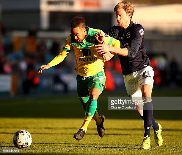 Norwich's Nathan Redmond looks to break away from Millwall's Dan Harding during the Sky Bet Championship match between Millwall and Norwich City at...