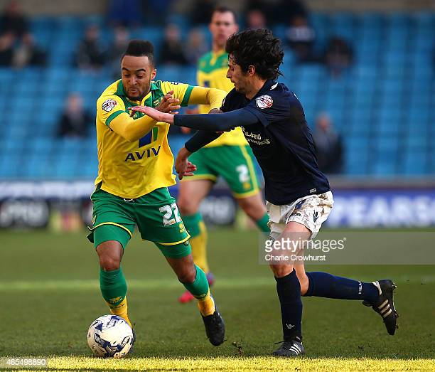 Norwich's Nathan Redmond looks to break away from Millwall's Diego Fabbrini during the Sky Bet Championship match between Millwall and Norwich City...