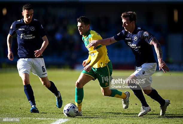 Norwich's Wes Hoolahan looks to break away from Martyn Woolford of Millwall during the Sky Bet Championship match between Millwall and Norwich City...