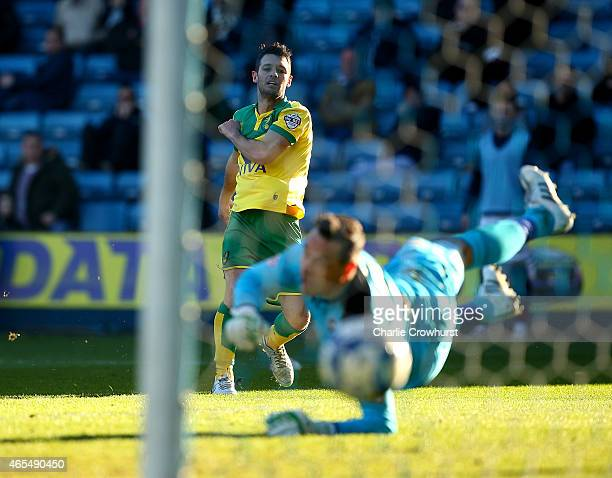 Norwich's Wes Hoolahan watches his shot as he scores the teams third goal of the game during the Sky Bet Championship match between Millwall and...
