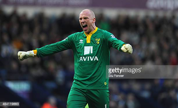 Norwick keeper John Ruddy celebrates the opening goal during the Barclays Premier League match between West Bromwich Albion and Norwich City at The...