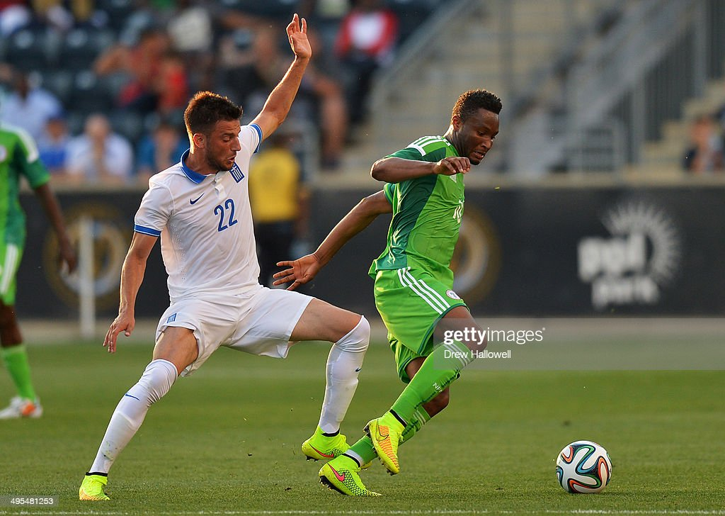 Nosa Igiebor #20 of Nigeria gains control of the ball in front of Andreas Samaris #22 of Greece during an international friendly match at PPL Park on June 3, 2014 in Chester, Pennsylvania.