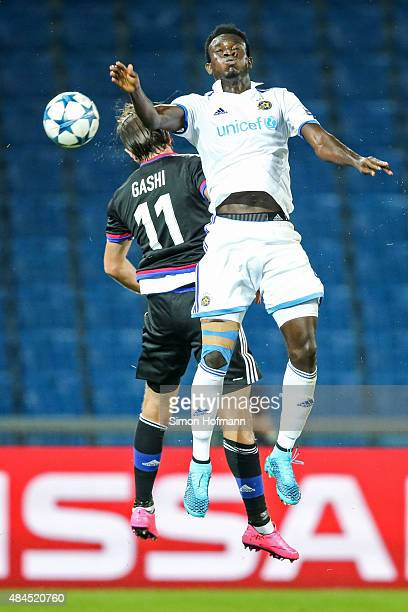 Nosa Igiebor of Tel Aviv jumps for a header with Shkelzen Gashi of Basel during the UEFA Champions League qualifying round play off first leg match...