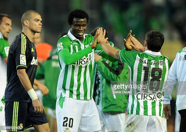 Nosa Iglebor and Salvador Agra of Real Betis Balompie celebrate after Betis beat Real 10 during the La Liga match between Real Betis Balompie and...