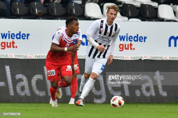 Nosa Iyobosa Edokpolor of FC Linz and Marko Raguz of Juniors OOe during the 2 Liga match between FC Juniors OOe v FC Blau Weiss Linz at TGW Arena on...