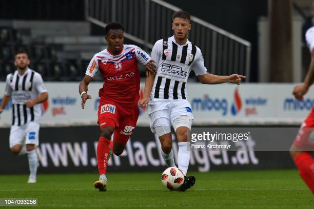 Nosa Iyobosa Edokpolor of FC Linz and Nemanja Celic of Juniors OOe during the 2 Liga match between FC Juniors OOe v FC Blau Weiss Linz at TGW Arena...