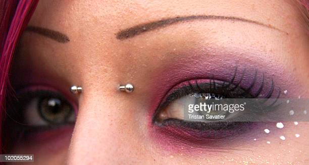Nose bridge piercing and eye makeup closeup