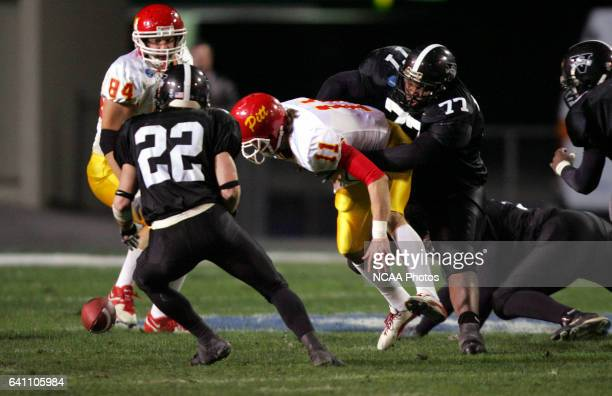 Nose guard Terei Toomer of Valdosta State University forces a fumble by quarterback Andy Majors of Pittsburg State University during the Division II...