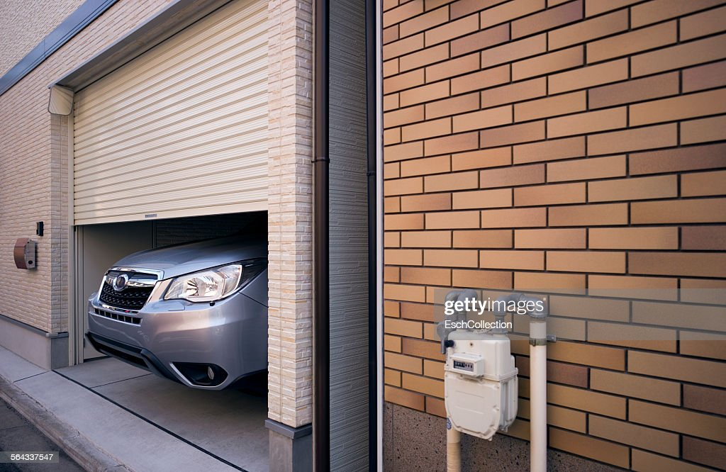 Nose Of Large Car Sticking Out Of Garage Stock Photo Getty Images